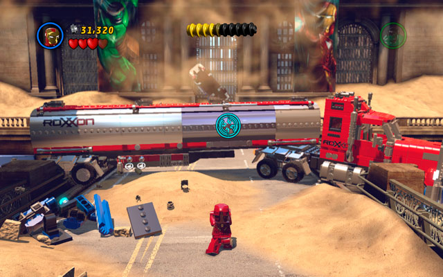 Approach to the next truck and use Iron Man's rocket attack - aim on the silver part of the vehicle and release the missiles - Sand Central Station - Walkthrough - LEGO Marvel Super Heroes - Game Guide and Walkthrough