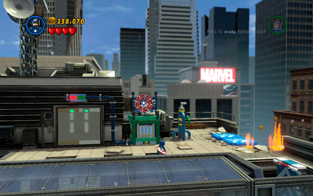 Standing there destroy all obstacles in the area, building a lift control machine from the debris - Times Square Off - Walkthrough - LEGO Marvel Super Heroes - Game Guide and Walkthrough