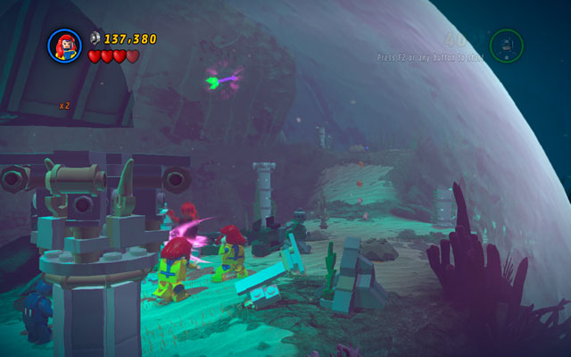 Right behind this location it is advisable to use Jean Grey's ability to yank a green-and-violet tentacle sticking out from the building above - That Sinking Feeling - Minikit Sets - LEGO Marvel Super Heroes - Game Guide and Walkthrough